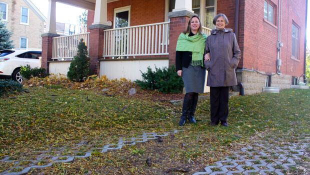 Catherine Fife and Elizabeth Mclaughin standing on their new driveway