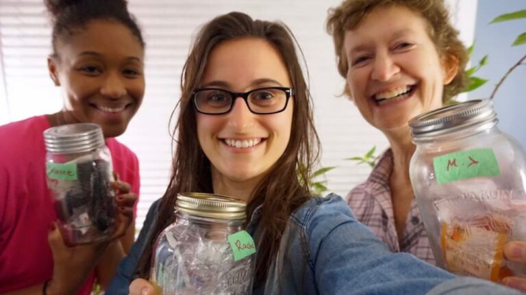 Selfie of 3 women, each holding a 1L mason jar