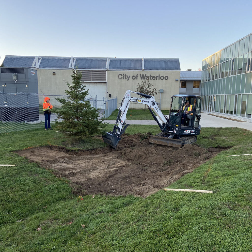 excavation of field area in front of waterloo service centre which will become a rain garden