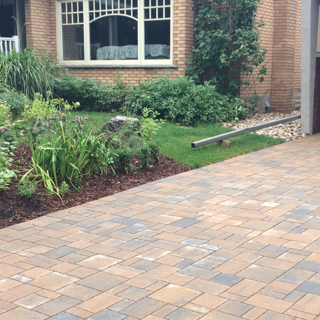 Reddish permeable paving stones on a driveway.