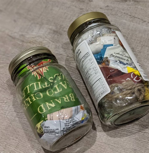 Two mason jars filled with garbage from the Zero Waste Challenge