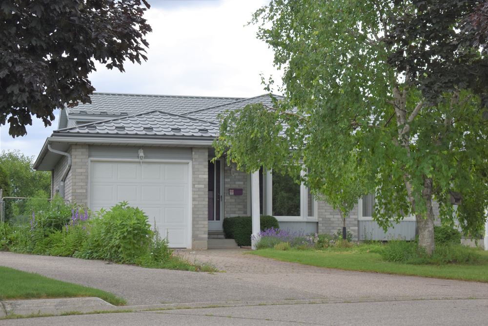 A grey house with a white garage