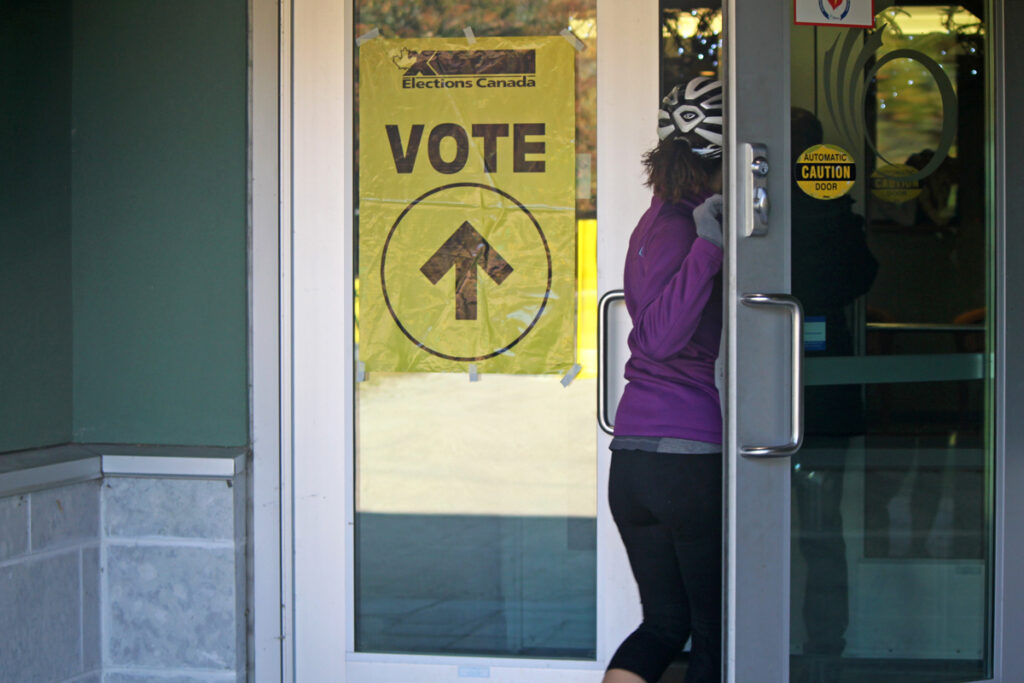 A person walks into a voting place